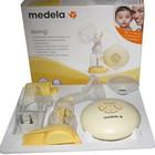 Medela Электрический молокоотсос Swing+ подарок Medela Система Calma  смартсоска
