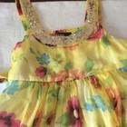 Желтое цветастое платье с блестками на 8-9 лет, рост128-135 см. Новое.