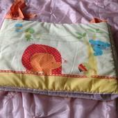Яркая защита на кроватку от mothercare