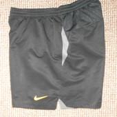 Фирменные спорт шорты Nike. Размер L