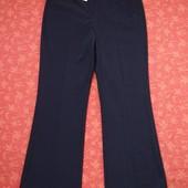 Новые брюки размер 12 (М). Длина 106 см, шаговый 79 см