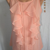 Персиковая блуза с валанами
