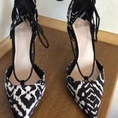 Туфли черно-белые бренда  Faith