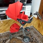 Червона коляска Stokke v3