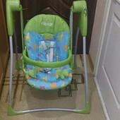Электронное кресло-качалку (Graco Baby Delight).