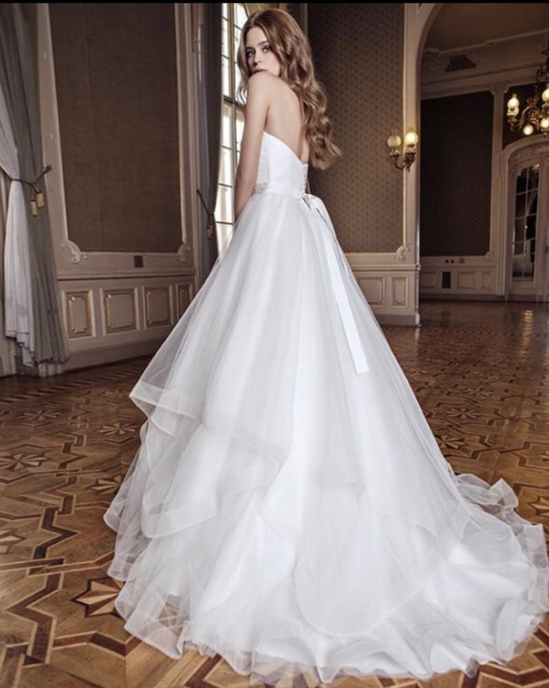 Срочно! шикарное фирменное свадебное платье с красивым шлейфом! еврофатин. dominiss mentes фото №1